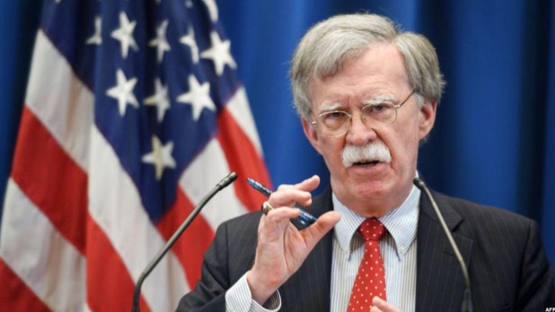 Photo of John Bolton: Siyaseta Trump xwe dispêre berjewendiyên bazirganiyê